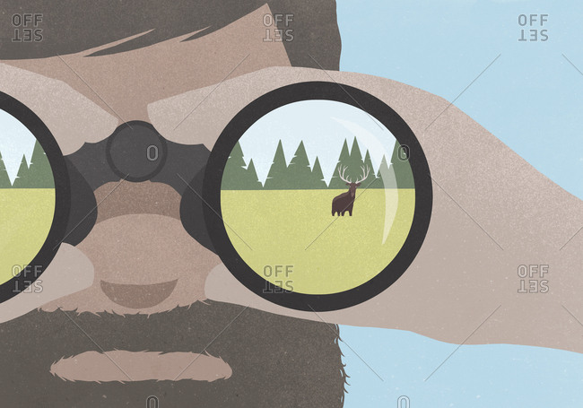 Reflection of moose in field in binoculars held by a man with a beard