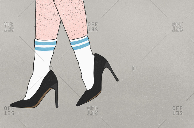 Low section of person with hairy legs wearing sports socks and high heels