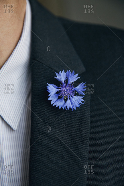 Blue flower pin on mans lapel