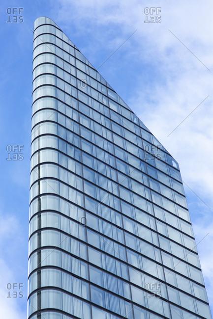 London, England - November 7, 2018: Modern corner building against cloudy sky