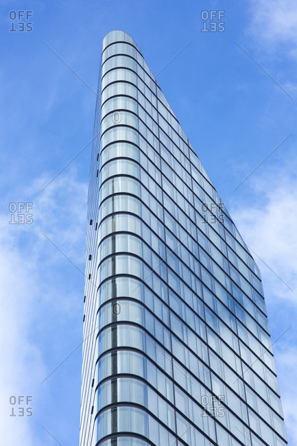 London, England - November 7, 2018: Modern corner building against cloudy blue sky