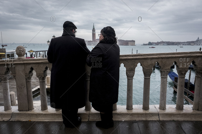 Venice, Portugal - December 11, 2017: Couple looking out at Venice seascape