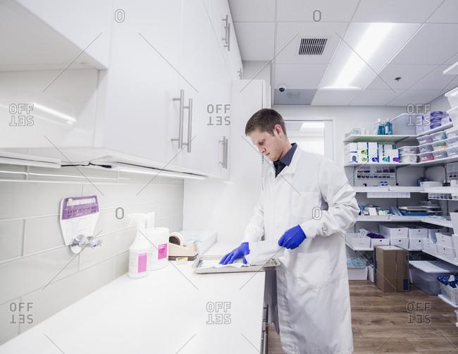 Dentist working in sterilization room