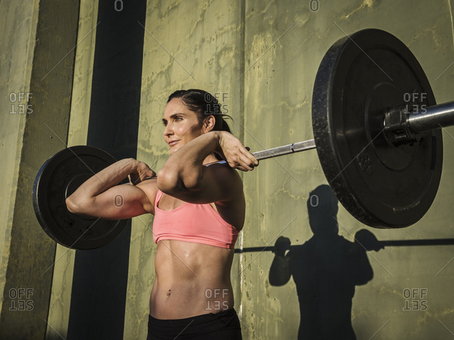 Woman weight lifting with barbell