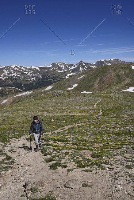 Woman hiking in mountains of Loveland Pass, Colorado