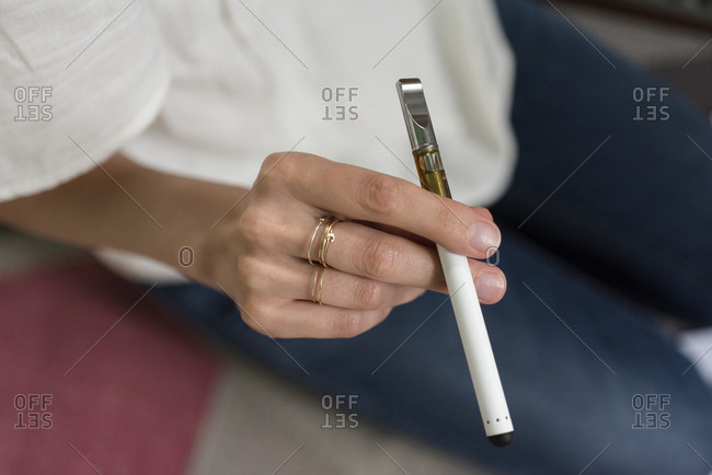 Hand of woman holding electronic cigarette