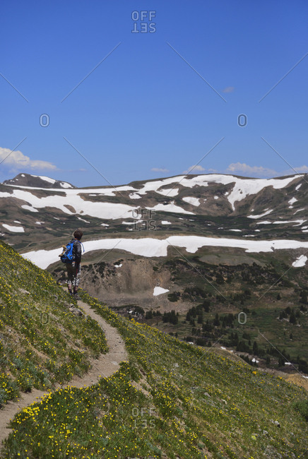 Woman looking at view while hiking on Loveland Pass, Colorado