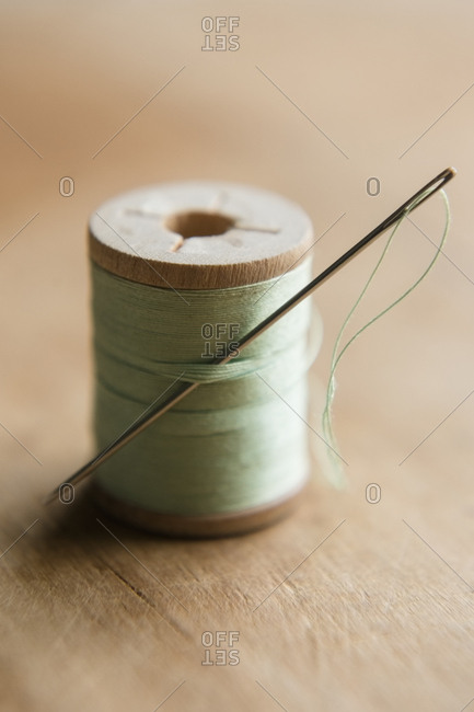 Green thread and needle