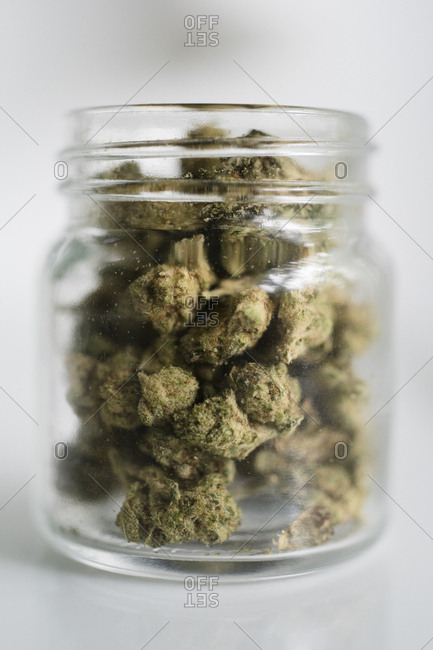 Glass jar filled with marijuana