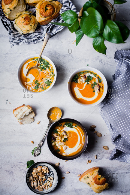 Pumpkin soup served with homemade baked bread