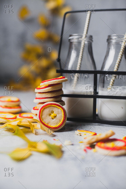 Button shaped sugar cookies served with milk