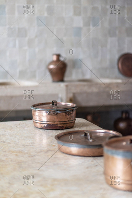 Copper pots on kitchen counter