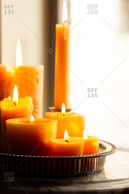 Arrangement of lit beeswax candles