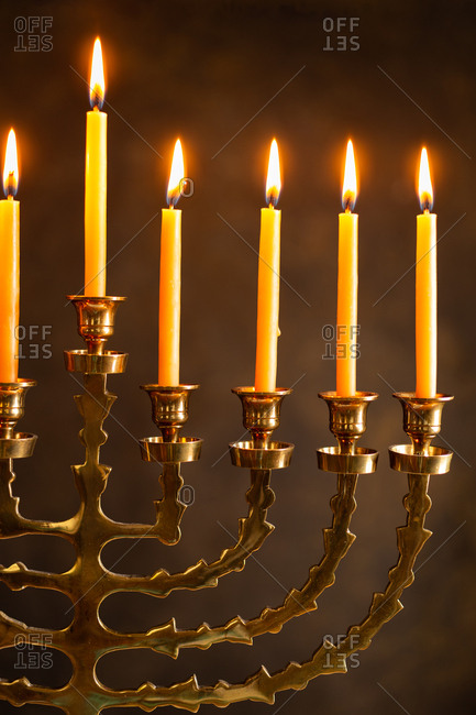 Close up of lit candles on a menorah