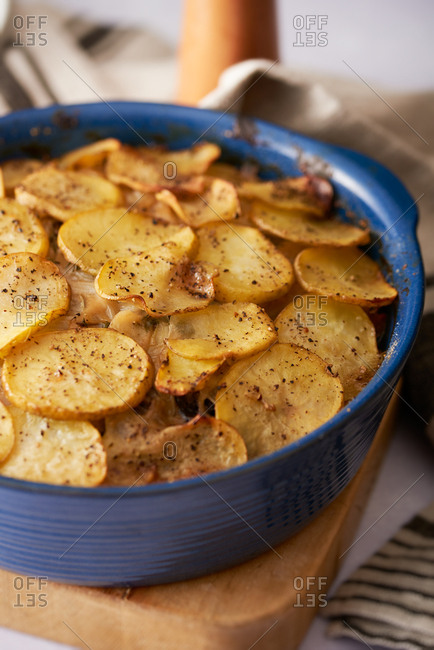 Hotpot topped with sliced potato