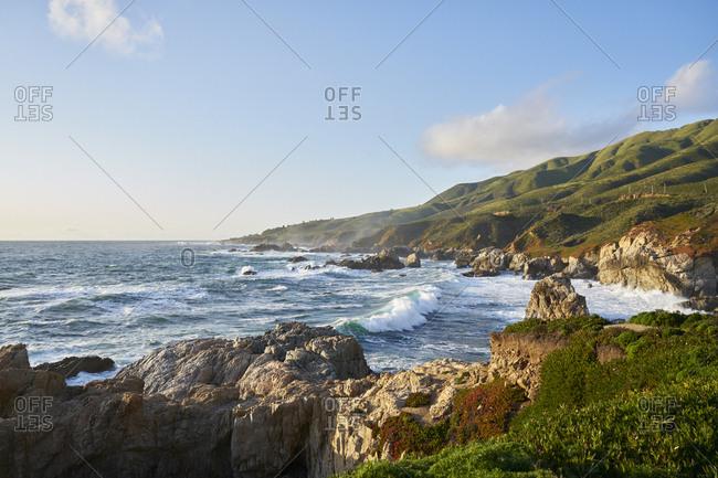 Waves by cliffs in Big Sur, USA