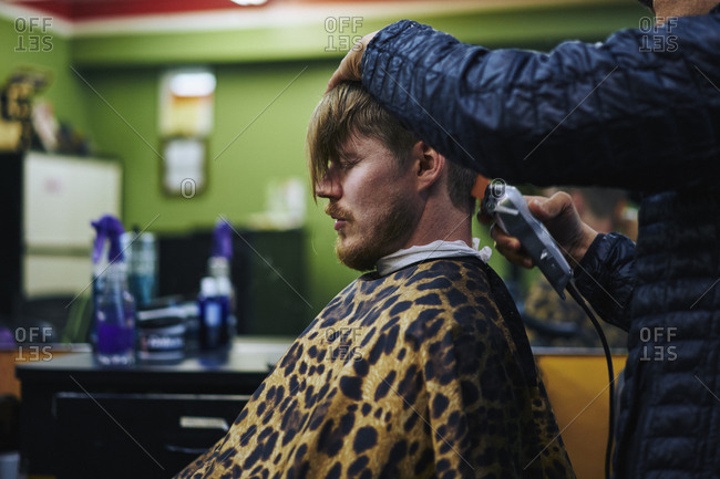 Man getting haircut in a barber in America