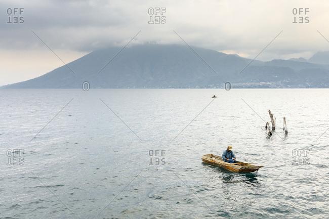 May 10, 2017: Fisherman in a boat on Lake Atitilan in Guatemala