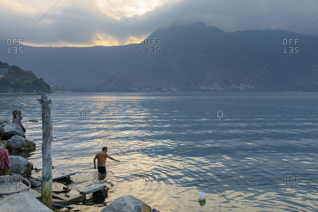 Man swimming in Lake Atitilan in Guatemala