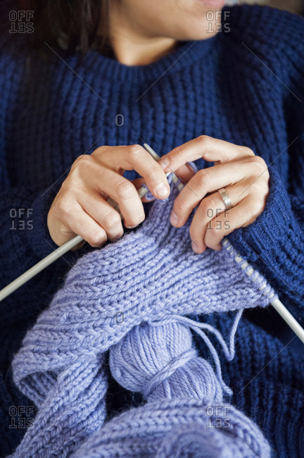 Young woman knitting in Sweden