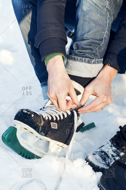 Lacing ice skates in Sweden