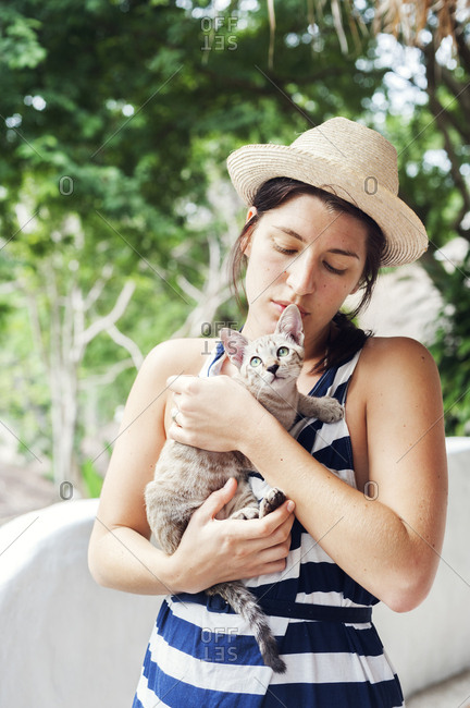 Young woman holding a kitten in Koh Tao, Thailand