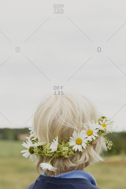 Boy wearing floral headband in Jarna, Sweden