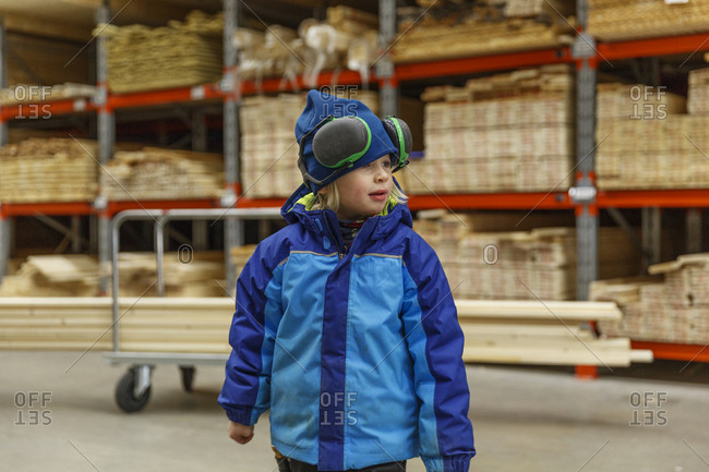 Boy in a lumberyard
