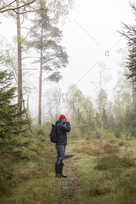 Mid adult man in a misty forest in Lerum, Sweden