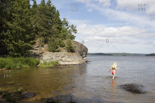 Girl wading in the sea in Mjorn, Sweden