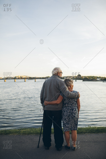 Senior couple standing by lake in Karlskrona, Sweden