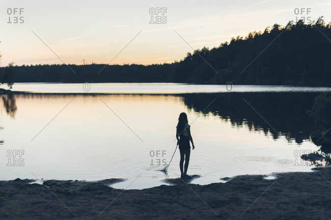 Girls at lake during sunset in Sweden