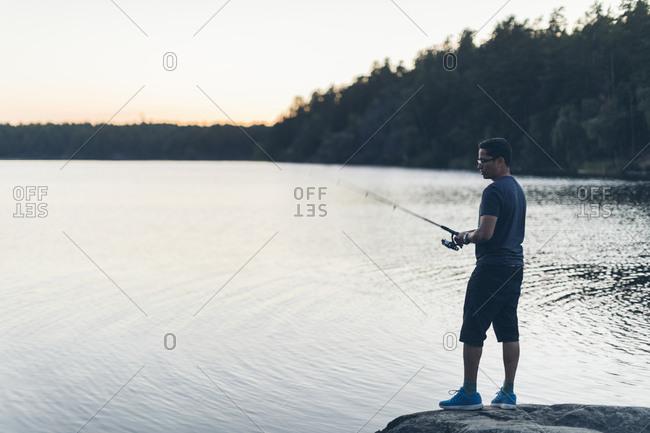 Man fishing at lake in Sweden