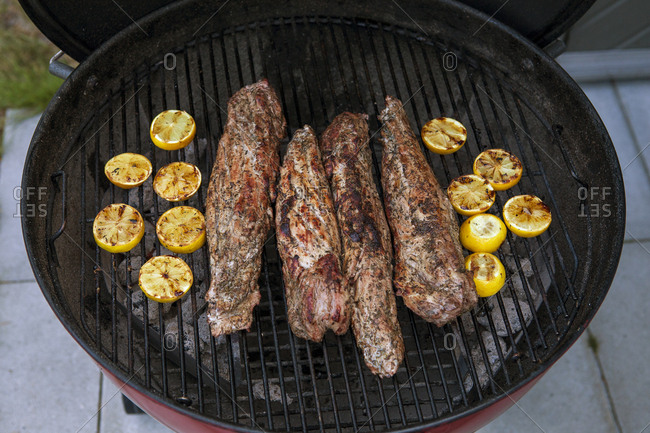 Tenderloin and lemons on a grill in Sweden