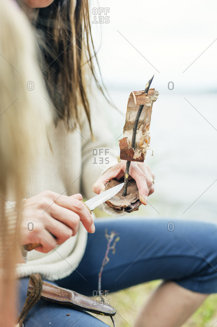 Woman making a tree bark boat in Finland