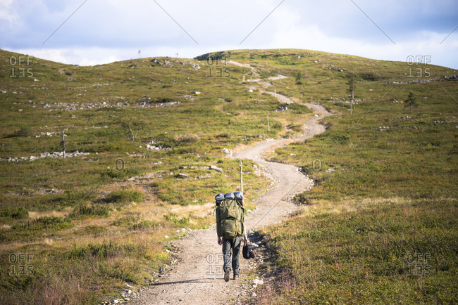 Person on a hiking trail at the Pallas-Yllastunturi National Park in Lapland, Sweden