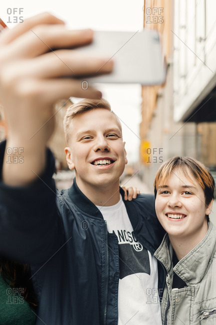Teenagers take a selfie on a city street in Sweden