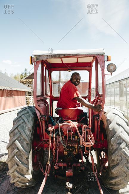 Garden centre worker on tractor