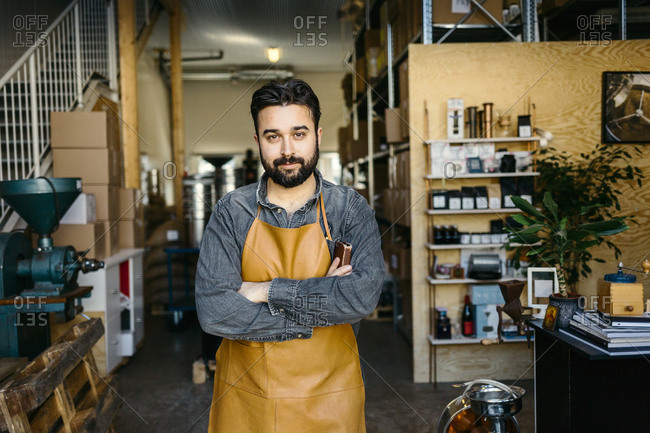 Small business owner in his coffee roaster shop