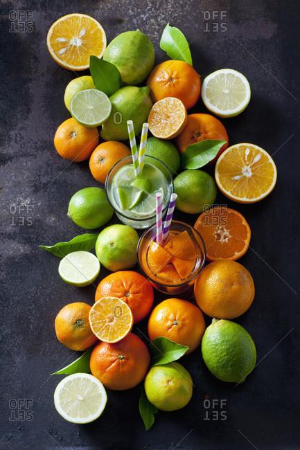Limes- lemons- oranges and tangerines on dark background