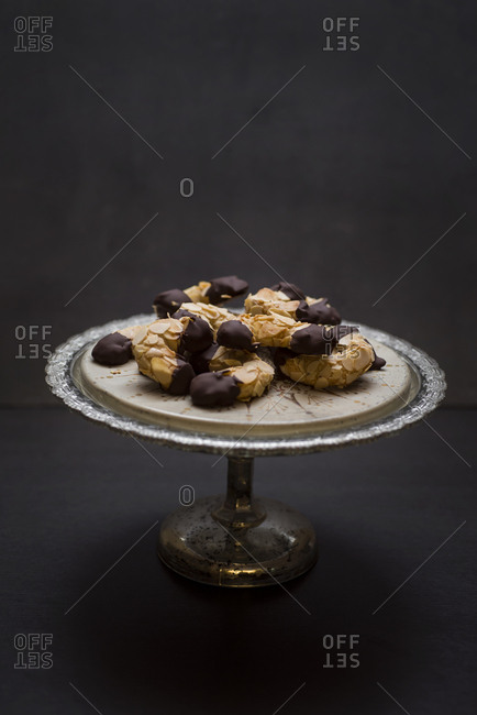 Vegan almond crescents on cake stand
