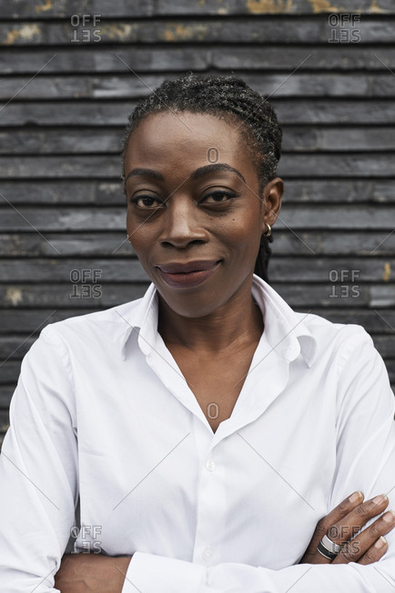 Portrait of smiling businesswoman wearing white shirt