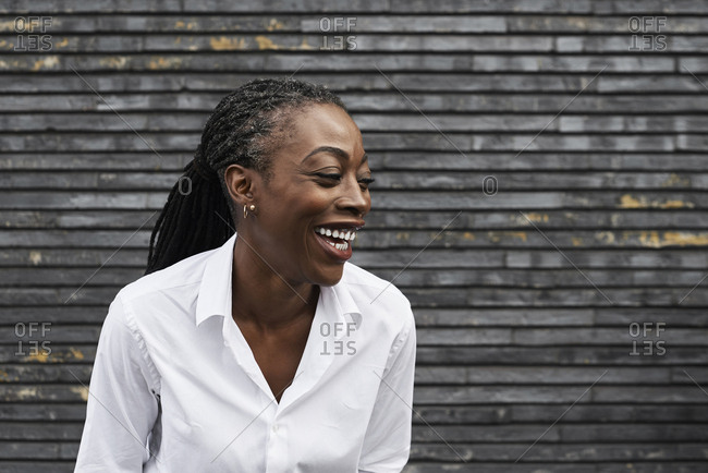 Portrait of laughing businesswoman  wearing white shirt