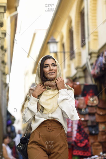 Spain- Granada- young muslim tourist woman wearing hijab during sightseeing in the city