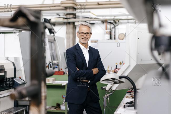 Portrait of a successful entrepreneur in his company