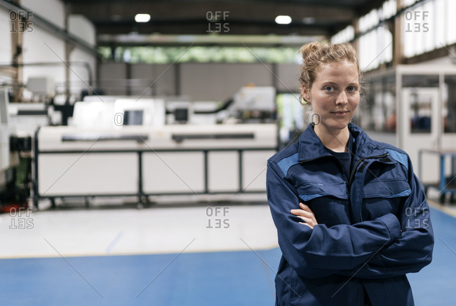 Young woman working as a skilled worker in a high tech company- portrait