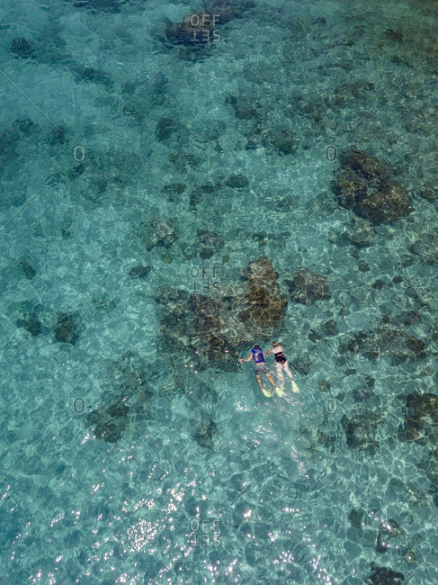 Indonesia- Bali- Aerial view of Blue Lagoon beach- snorkelers