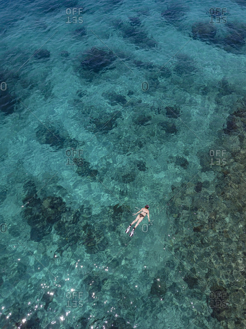 Indonesia- Bali- Aerial view of Blue Lagoon- snorkeler