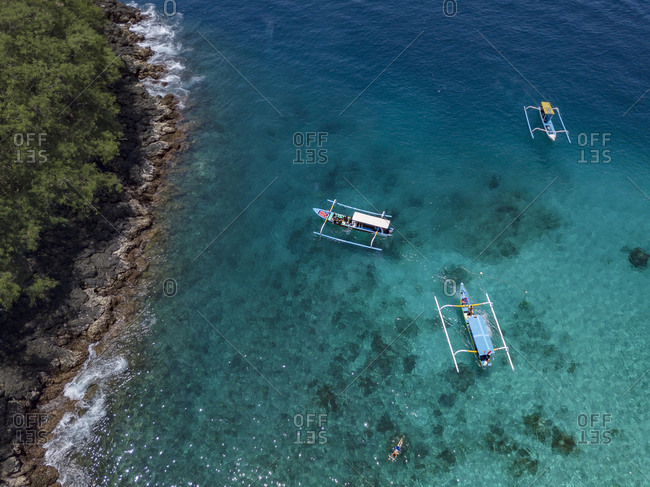 Indonesia- Bali- Aerial view of Blue Lagoon beach- banca boats
