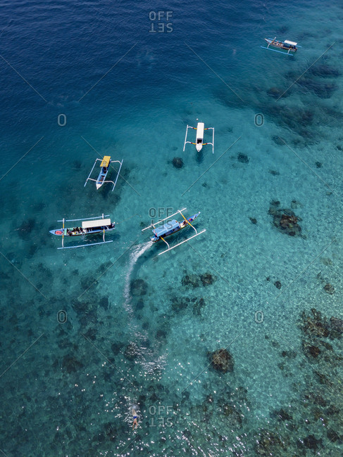Indonesia- Bali- Aerial view of Blue Lagoon- banca boats